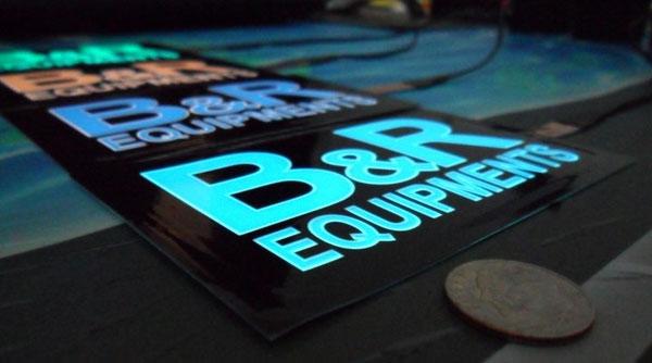 Commande groupée (CG) de logos électroluminescents